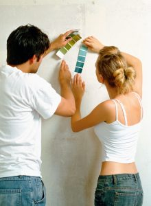Couple using colour swatches