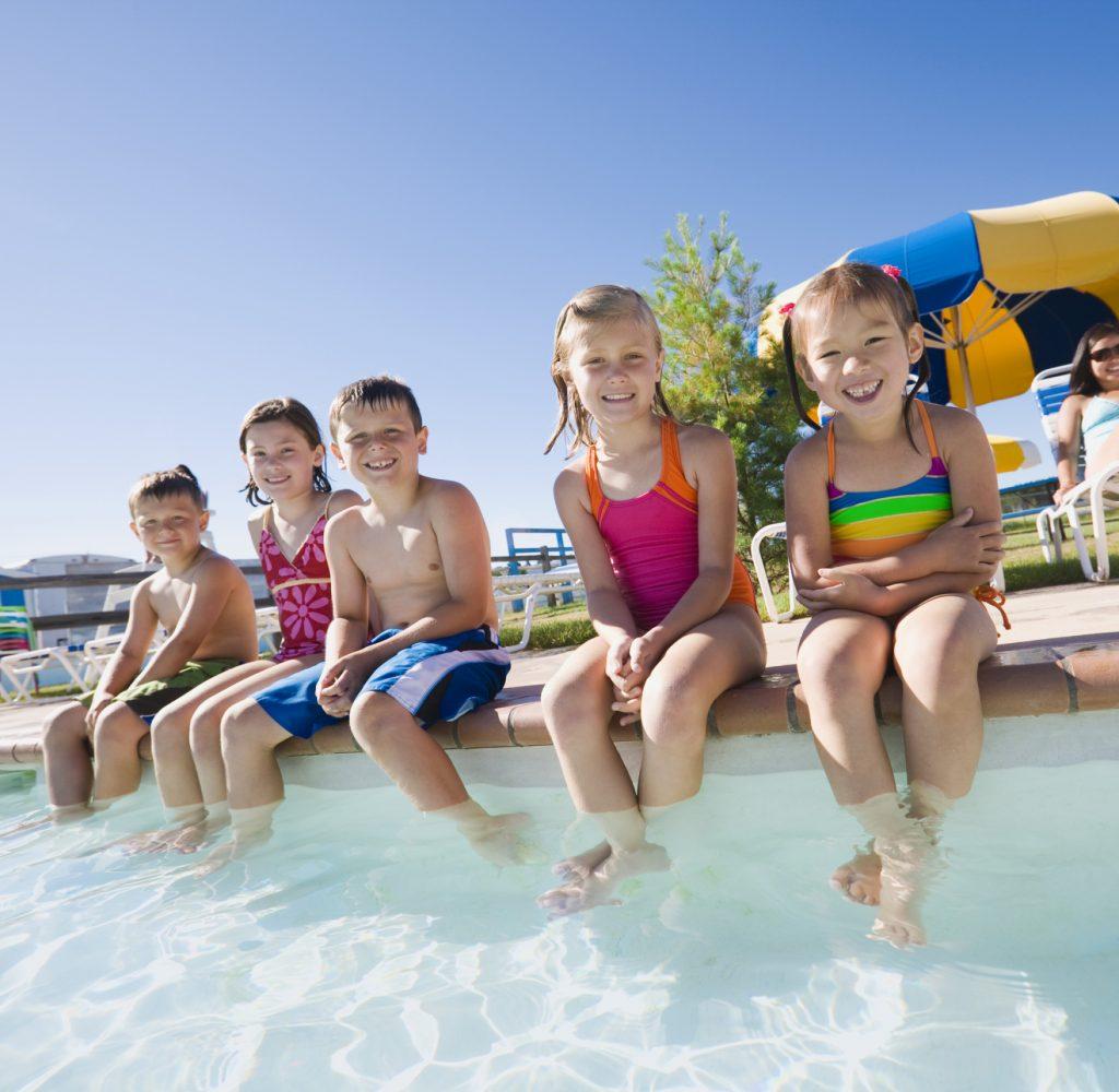 Kids sitting by pool