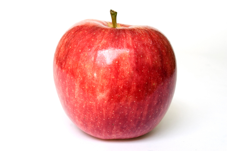 A stock photograph of an apple looking fresh, ripe and healthy.
