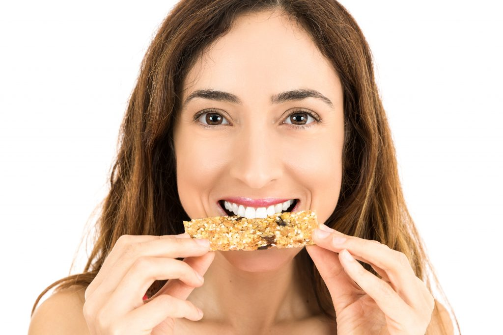 Woman eating energy bar